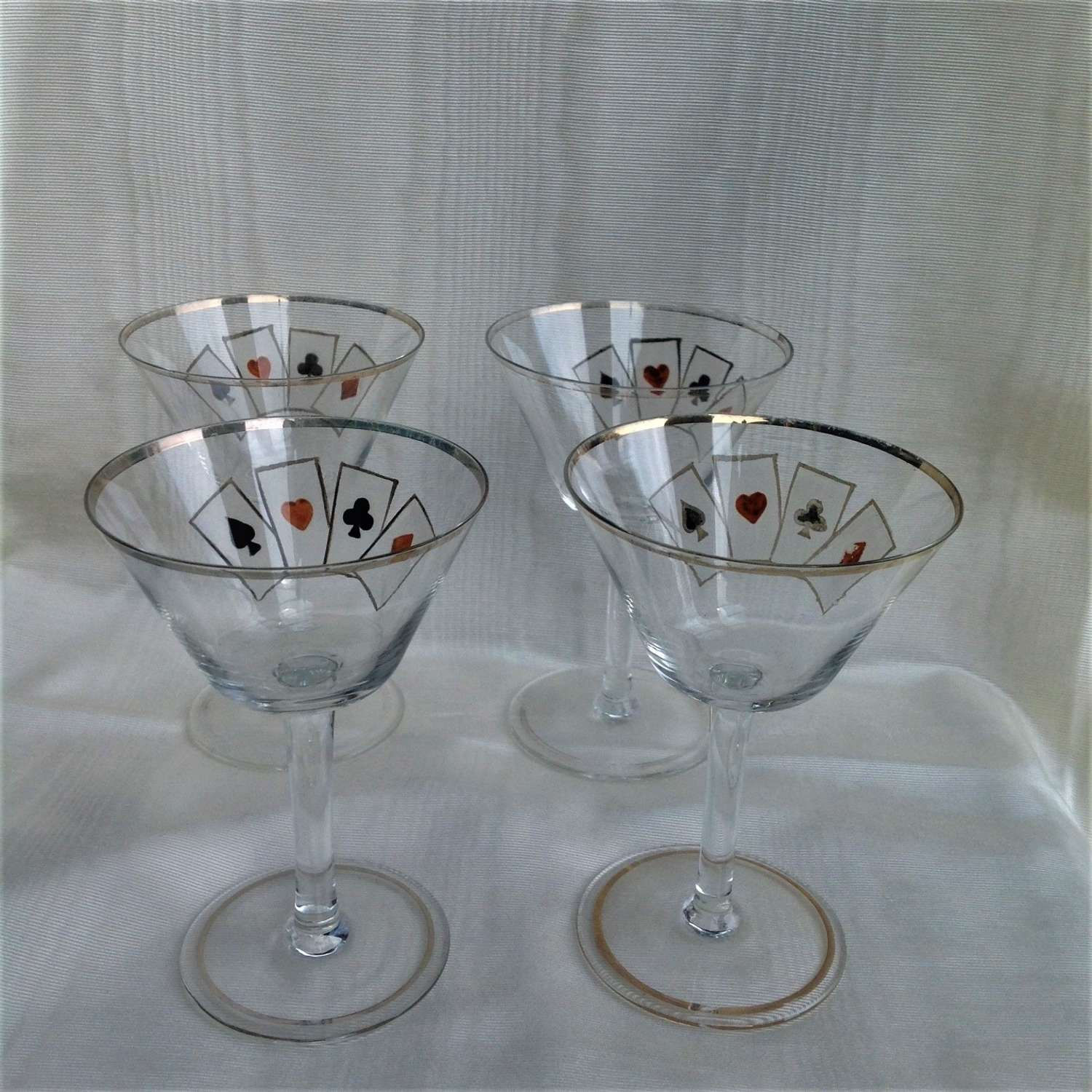 Four delicate hand-enamelled art deco playing card cocktail glasses