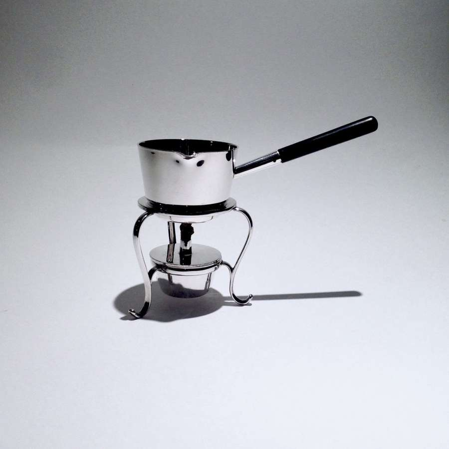 A charming small silver plated, pan shaped spirit or brandy warmer