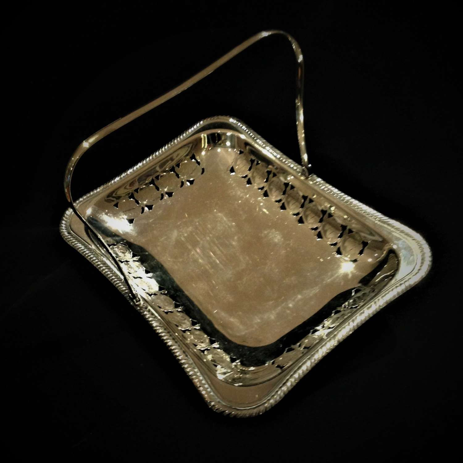 Decorative silver plate on copper basket with swing handle