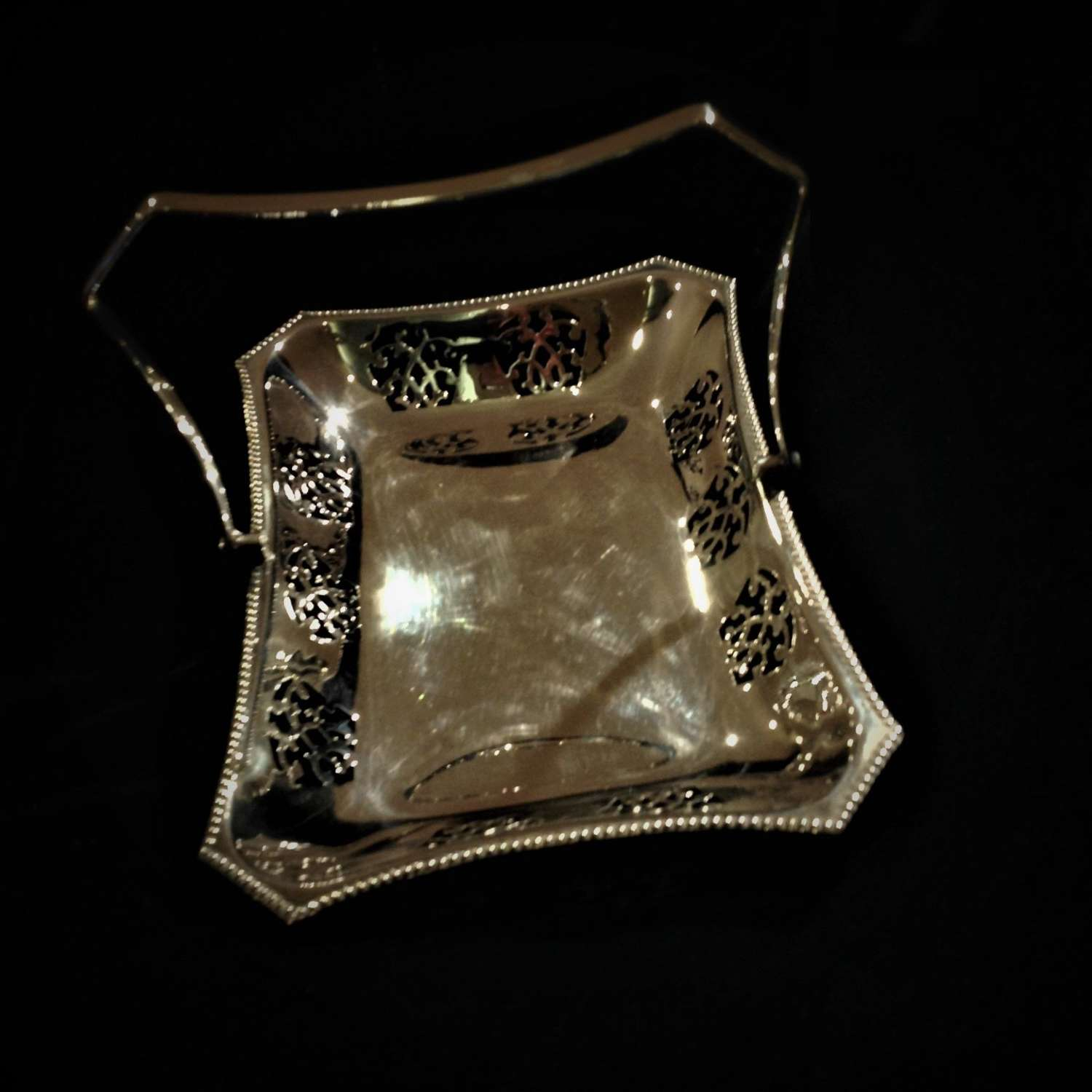 Decorative silver plated swing-handled basket