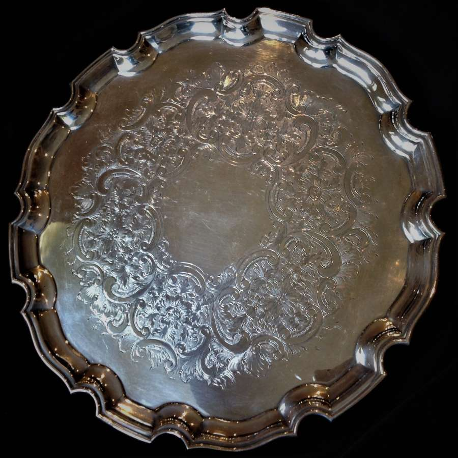 Circular, silver plated scalloped edge serving tray