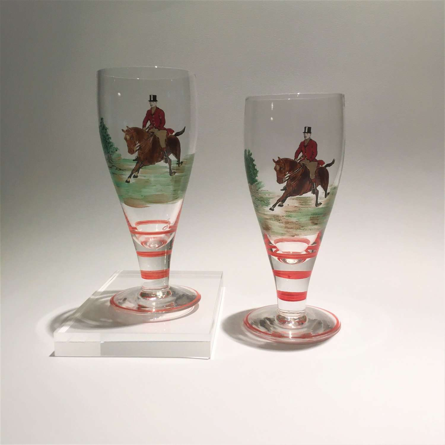 A pair of Art Deco hand enamelled