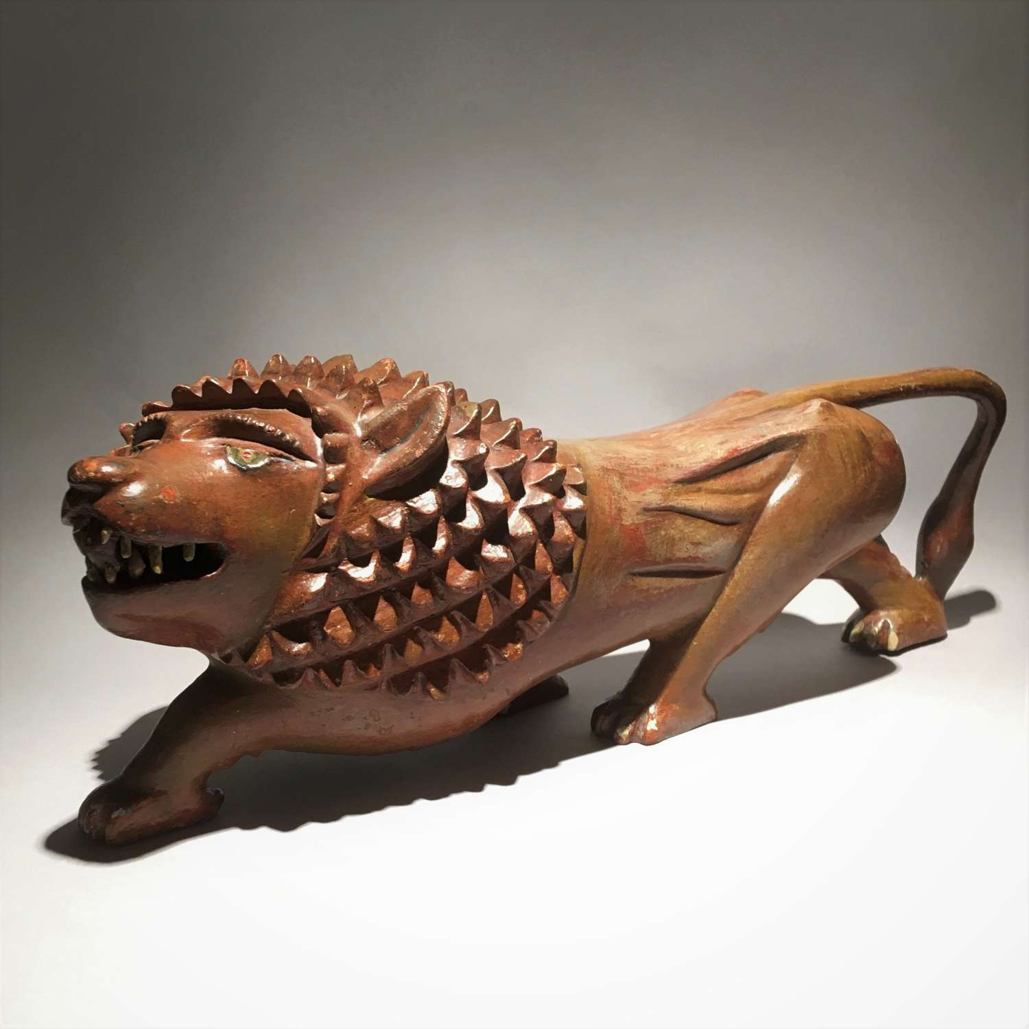 Folk Art Sculpture of a Prowling Lion