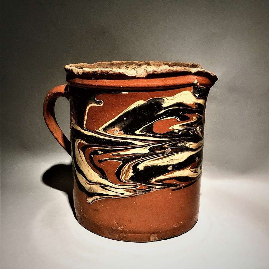 Wonderfully patinated antique French marbled slipware