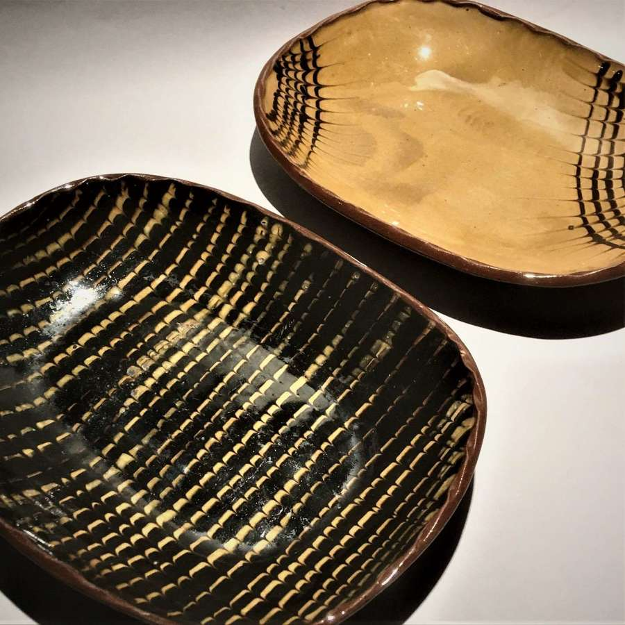 A pair of Cricklade Studio Pottery Feathered Slipware Dishes