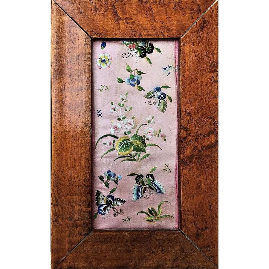 Framed section of pink silk embroidered with butterflies & flowers