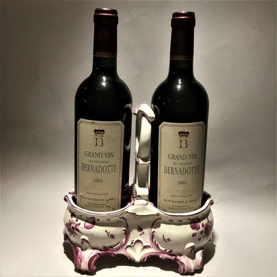 An unusual faïence, tin-glazed earthenware, double wine bottle coaste