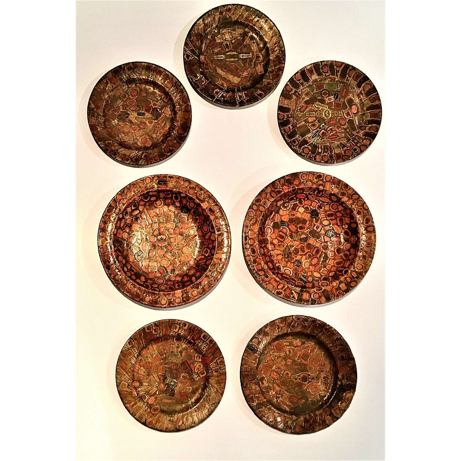 An attractive set of seven (7) cigar band decoupage plates